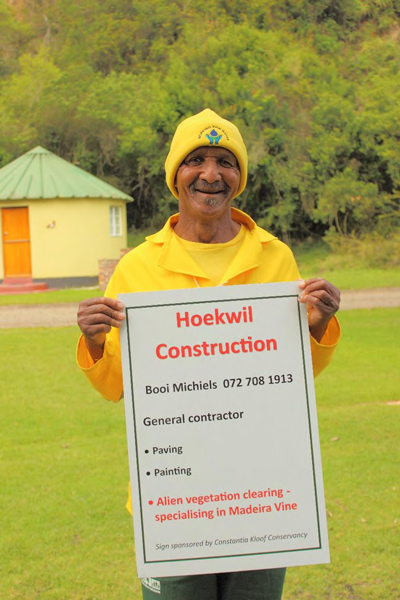 Oom Booi Michiels proudly displaying his new sign. The small print at the bottom states that the sign has been sponsored by the CKC.